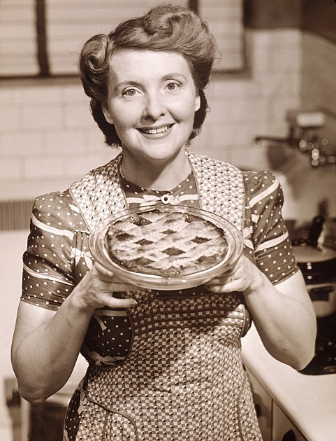 Aproned Housewife Presents Homemade Pie