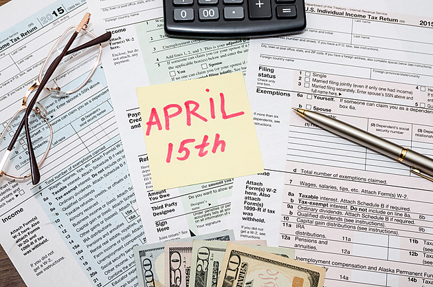 1040 tax form with stick april 15,  dollar  and calculator