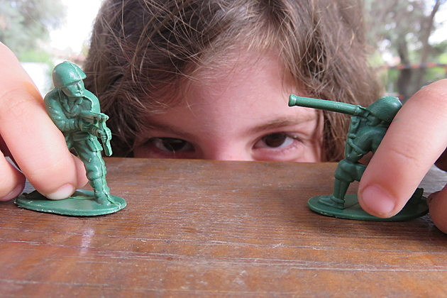 Playing with toy soldiers