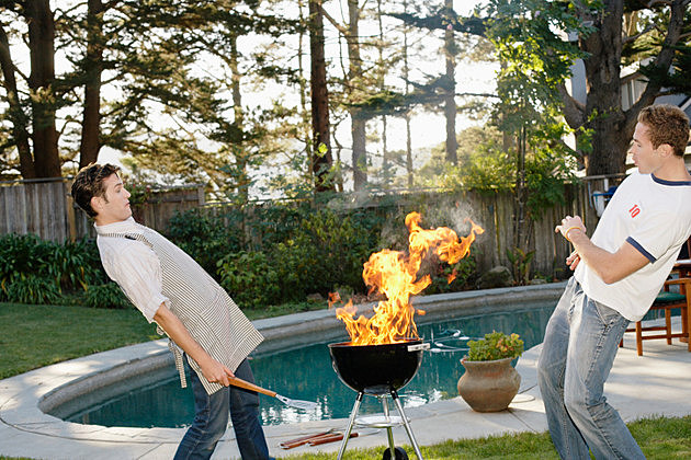 Young Men Avoiding BBQ Fire
